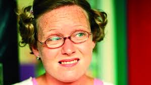 Ursula Holden Gill eye squint and thick glasses